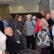 Retired faculty begin to assemble for a building tour.