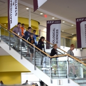 Students walking downstairs to atrium