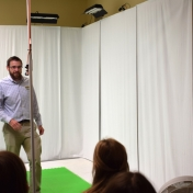Dr. George Landon stands in front of white screens in Motion Capture Studio