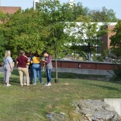 A group of Madison Southern High School students collect measurements