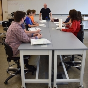 Dr. Hughes conducts activity with Berea Independent students