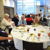 Retired Math, Computer Science, and Philosophy faculty seated at table.