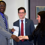 Tom Otieno and Andrew Polter accept check from Novelis rep, Tammy Peyton