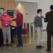Faculty and staff enjoy chips and sandwiches at the reception
