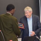 Dr. Tom Otieno presents Dr. Gary Booth with College of Science Award