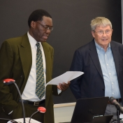 Dr. Tom Otieno presenting Dr. Gary Booth's contributions to EKU