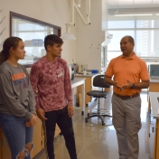 Dr. Karim Abdelhay talks with a group of students
