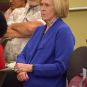 Jane Booth watches as Gary Booth receives award
