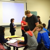 Graduate student, Zachary Morgan leads students in probability games