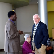 Dr. Tom Otieno speaks with Donald Whitaker, College of Science award recipient