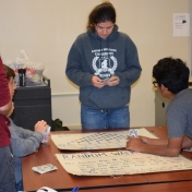 Math tutor, Shastina Bryant leads a probability game with Model students