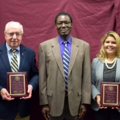 Award Recipients Donald Whitaker and Erika Gil Winter pose with Dr. Otieno