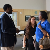 Dr. Tom Otieno visits with representatives from Novelis Corporation