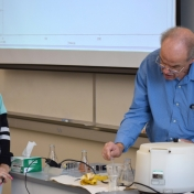 Madison Southern student assists Dr. Brock in preparing a sample.