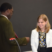 Dr. Tom Otieno presents Dr. Tracie Prater with College of Science Award