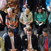 The audience listens to speakers at dedication ceremony.