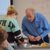 Dr. Martin Brock inspects students work.