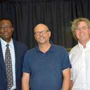 Tom Otieno and Erik Liddell pose with Chautauqua keynote speaker Oswald Schmitz