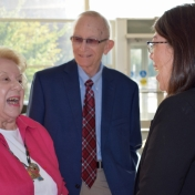 Dr. and Mrs. John Davidson talk to Dr. Betina Gardner