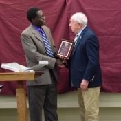 Dr. Tom Otieno presents Donald Whitaker with the College of Science award